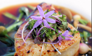 Chilean Sea Bass, Asian consume, Floating veggies with Garlic Flowers